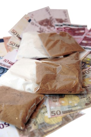 a stash of drugs and money showing a high cost to life against a white background Stock Photo - 4007936