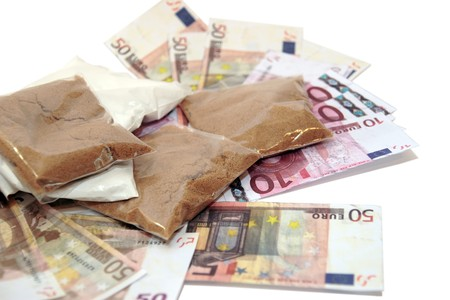 stash: a stash of drugs and money showing a high cost to life