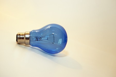 volts: a blue lightbulb on a clean background