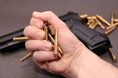 stash: a stash of bullets in the hands and a gun