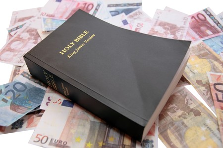the king james version bible with money showing believe and receive Stock Photo - 4219106
