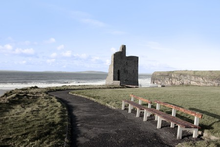 kerry: benches beside a castle in ballybunion county kerry ireland Stock Photo
