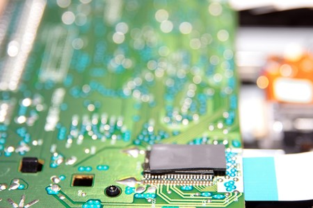 close up of a green and blue printed circuit board photo
