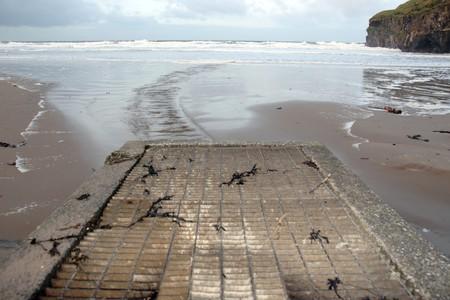 a storm drain on a beautiful beach photo