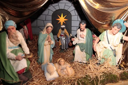 scene of the birth of christ in a stable