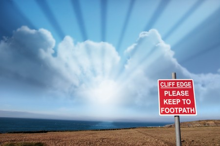 cliff edge: a warning sign of danger at the cliff edge