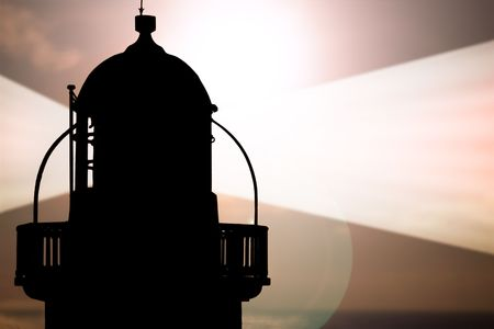 lighthouse captured with the sun behind it and beams on Banco de Imagens