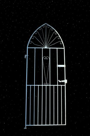 pearly gates: a white wrought iron gate (with path) depicting gateway to the universe