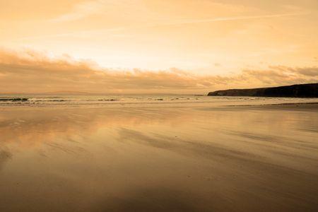 kerry: the waves with reflection crashing in on ballybunion beach ireland Stock Photo