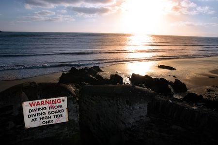 youghal: a warning sign on the cliffs in youghal county cork ireland