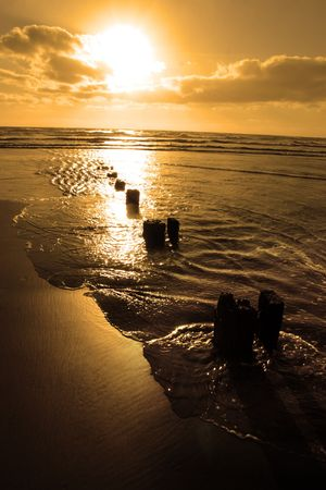 wave breakers at sunset on a golden beach in youghal county cork ireland Stock Photo - 4813043