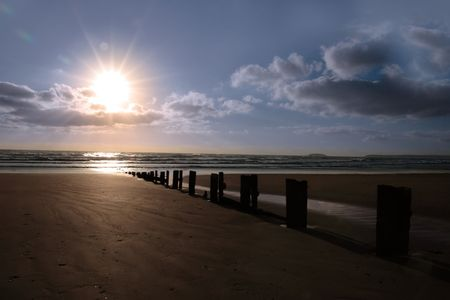wave breakers at sunset on a beach in youghal county cork ireland Stock Photo - 4813038