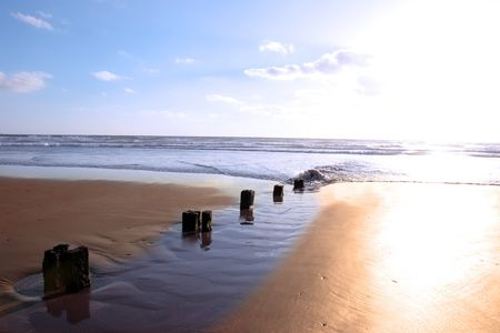 wave breakers at sunset on a beach in youghal county cork ireland Stock Photo - 4813052