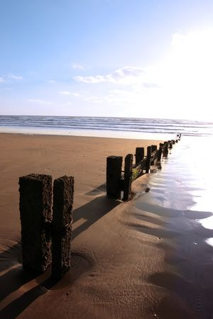 wave breakers at sunset on a beach in youghal county cork ireland Stock Photo - 4813042