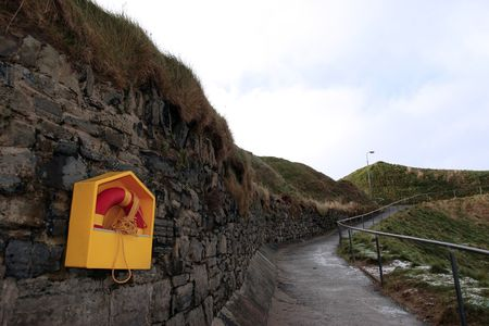 kerry: winters snow on the ballybunion cliffside walk with safety buoy