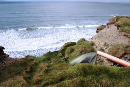sea poison: waste flowing out of a pipe on the atlantic coast
