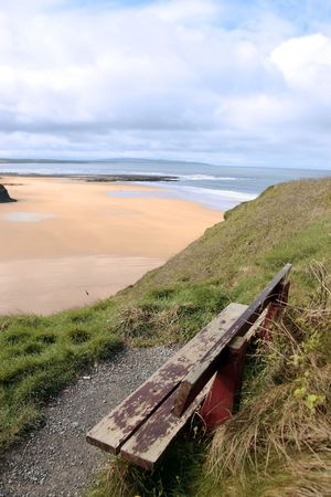 ballybunion bench in winter with view of castle beach and cliffs photo