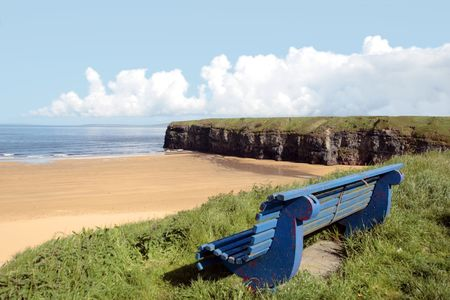ballybunion bench with view of beach and cliffs photo