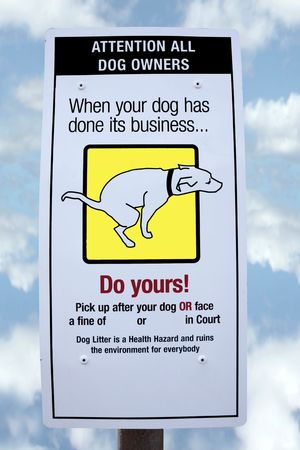 sign warning about fines for dogs fouling with cloudy background photo