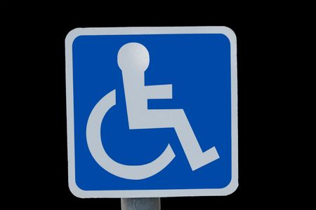 universal wheel chair sign isolated on black photo