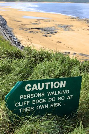 a caution sign on a cliff edge in ballybunion photo