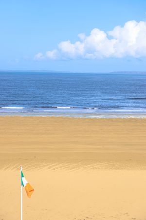 co  kerry: a view of the beach in ballybunion co kerry ireland with irish flag