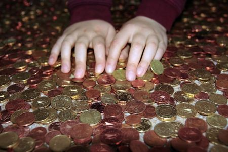 takings: hands grabbing lots of loose change in euro cents Stock Photo