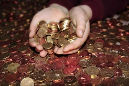hands grabbing lots of loose change in euro cents Stock Photo - 5335020