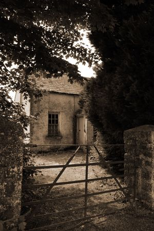 an old decaying cottage front in ireland photo