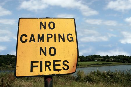 no fires: a no camping no fires sign in knockanore county waterford in the south of ireland in summer on the blackwater river edge