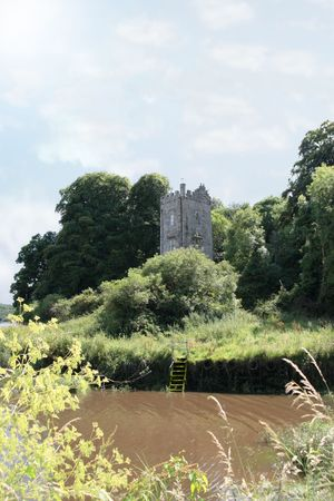 blackwater: a castle tower in knockanore county waterford in the south of ireland in summer on the blackwater river edge