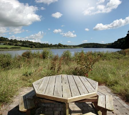 blackwater: a picnic bench in knockanore county waterford in the south of ireland in summer on the blackwater river edge