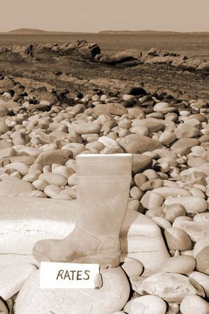 an old abandoned farmers boot illustrating farming at sea and rates photo