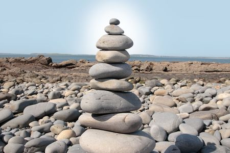 rocks balanced on a calm spiritual beach on the sunny coast of ireland photo