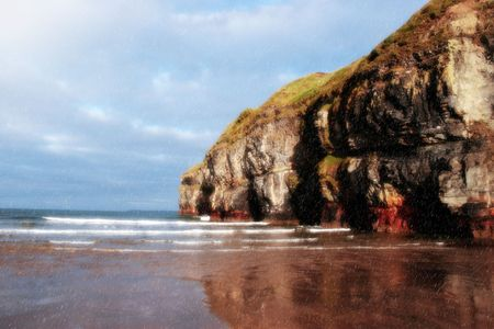 co  kerry: a view of the beach cliffs in ballybunion co kerry ireland with reflection on a wet rainy day