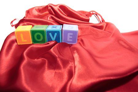 silky lingerie: love written with blocks on a silk nightie Stock Photo