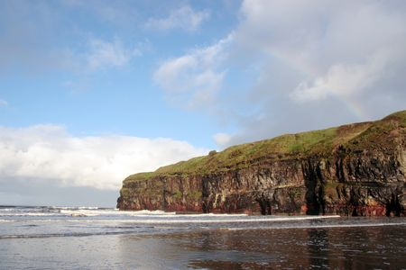 co  kerry: a view of the beach cliffs in ballybunion co kerry ireland with rainbow  Stock Photo