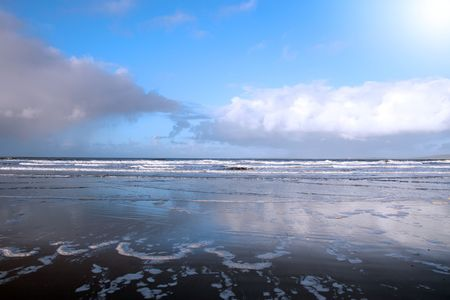 ballybunion: the waves with reflection crashing in on ballybunion beach ireland during winter