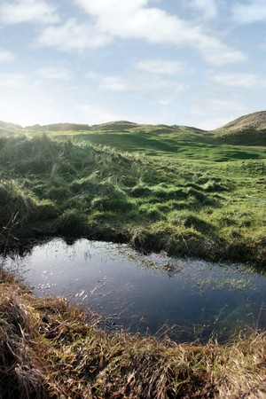 a water trap on a links golf course in ireland photo