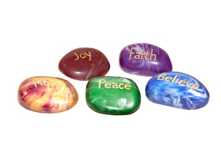 five stones inscribed hope joy peace faith and believe