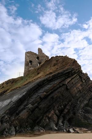 ballybunion castle on the rocks in the west coast of ireland photo