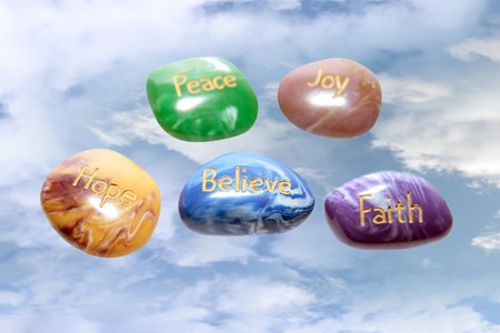 five stones inscribed hope joy peace faith and believe in the heavens Stock Photo - 7309032