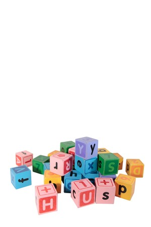 assorted childrens toy letter building blocks against a white background with copy space Stock Photo - 7390320