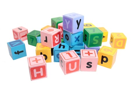 assorted childrens toy letter building blocks against a white background Stock Photo - 7390337