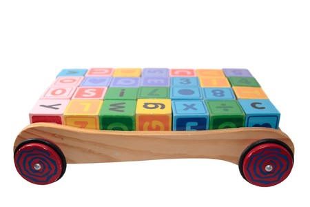 childrens toy letter building blocks all together in a toy cart isolated on white background Stock Photo - 7390331