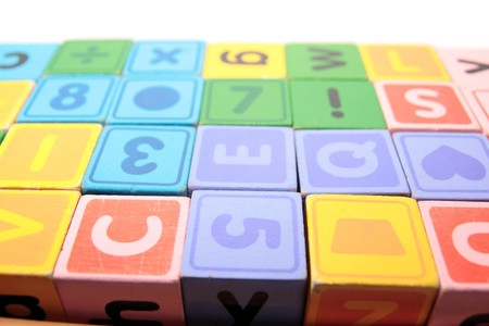 childrens toy letter building blocks against a white background Stock Photo - 7390355
