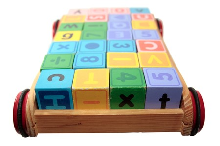 childrens toy letter building blocks all together in a toy cart isolated on white background Stock Photo - 7390345