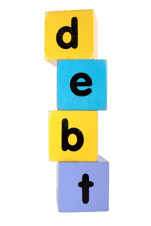 assorted childrens toy letter building blocks against a white background that spell debt photo