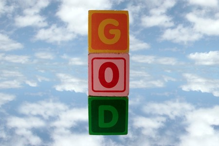childrens toy letter building blocks against a cloudy background spelling god photo