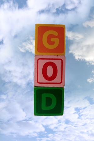 childrens toy letter building blocks against a cloudy background spelling god Stock Photo - 7478019
